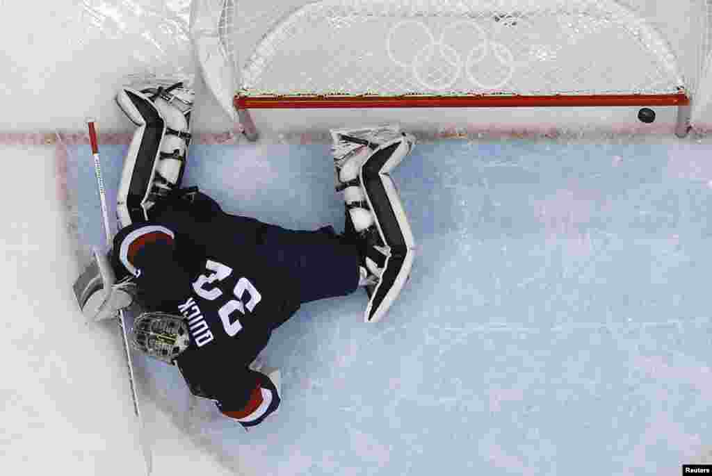 The U.S. team goalie, Jonathan Quick, lets in a goal by Finland's Teemu Selanne during the first period of their men's ice hockey bronze medal game. (Reuters/Mark Blinch)