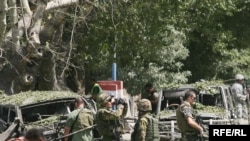 NATO soldiers secure the site of the attack on August 15