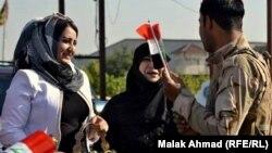ناشطات يزرن وحدات قوات أمنية في بغداد