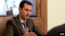 Key details, such as Syrian President Bashar al-Assad's role in the transition, remained unresolved.