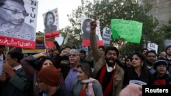 Human rights activists chant slogans during a protest to condemn the disappearances of social activists in Karachi on January 19.