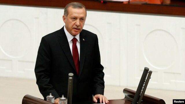 Turkey -- Turkish new President Tayyip Erdogan attends a swearing in ceremony at the parliament in Ankara, August 28, 2014