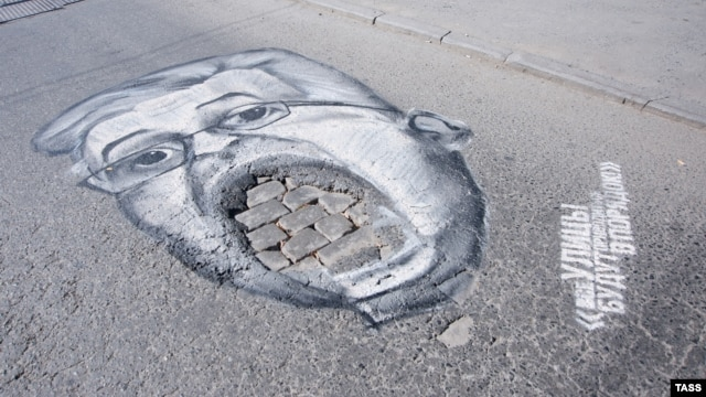 A pothole caricature of Yekaterinburg City Manager Aleksandr Yakob