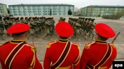 Georgian soldiers march at the military base of Vaziani outside Tbilisi during a farewell ceremony marking their departure to Afghanistan to take part in NATO's Resolute Support mission on March 24.