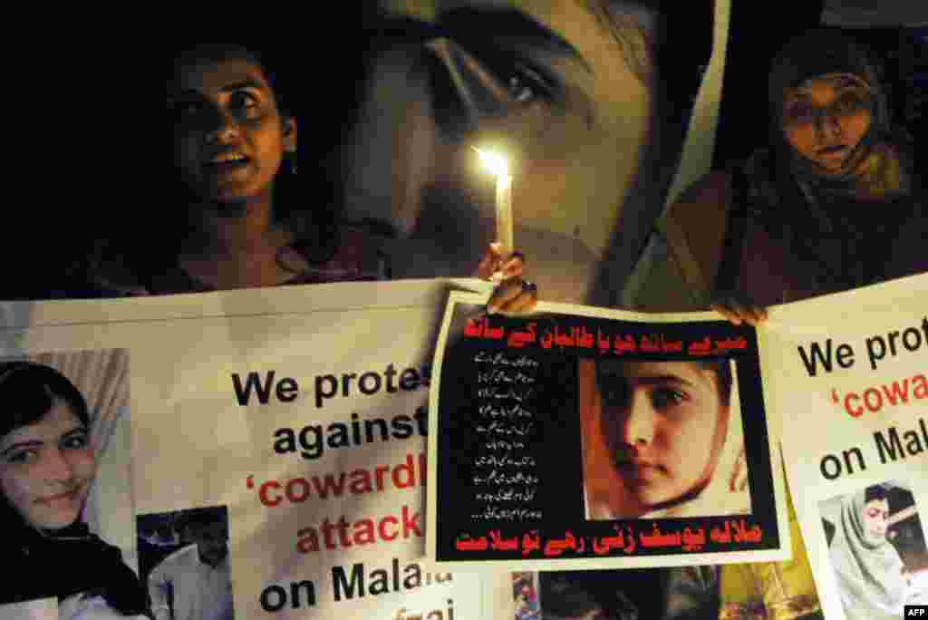 Civil society activists carry candles to pay tribute to Malala in Lahore.