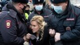 RUSSIA -- Police officers detain the Alliance of Doctors union's leader Anastasia Vasilyeva at the prison colony IK-2, which stands out among Russian penitentiary facilities for its particularly strict regime, in Pokrov in the Vladimir region, April 6, 20