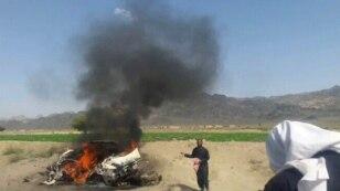 A car is seen on fire at the site of a U.S. drone strike in Pakistan that is believed to have killed Afghan Taliban leader Mullah Akthar Mansur.
