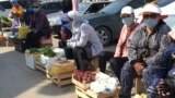 Kazakhstan-Aktobe. Market vendors located near the closed market. May 25, 2020