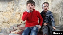 Sirya -- Injured boys react at a field hospital after airstrikes on the rebel held areas of Aleppo, November 18, 2016