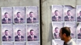 Iraq -- Election posters plasters of Omar Faruq al-Ani, one of the three candidates who were killed, Baghdad, 30Jan2009