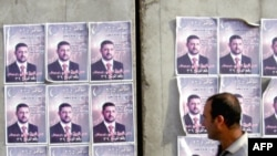 Election posters plastered on a wall in Iraq, January 2009.