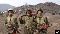 Basij members pose for a picture during a military exercise outside the holy city of Qom in central Iran.