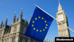 Generic – European Union flag hanging in front of Big Ben and the Houses of Parliament at Westminster Palace, London, in preparation for the Brexit EU referendum