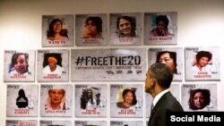 Obama #FreeThe20 stendini nəzərdən keçirir.
