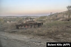 A destroyed tank near the empty village where Hayk was fighting