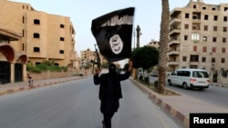 A member of the Islamic State militant group in Raqqa, Syria.