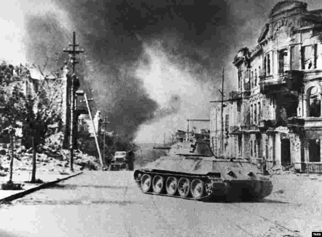 A T-34 on a city street in Sevastopol, Crimea, after the city was liberated by the Red Army from the Nazi German occupation in 1944.