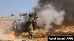 Pamje të rebelëve në rajonin Idlib, Siri. Foto ilustruese.