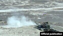 Azerbaijan - A Russian-manufactured tank opens fire during an Azerbaijani military exercise, 26Jun2014.