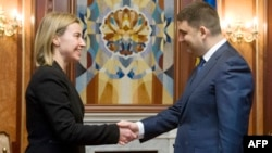 EU foreign policy chief Federica Mogherini (left) made her comments on December 8 after meeting with Ukrainian Prime Minister Volodymyr Hroysman (right) in Brussels. (file photo)