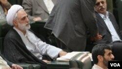 محسنی اژهای (سمت راست) و محمود احمدینژاد، رییس جمهوری پیشین ایران
