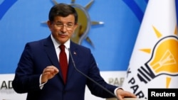 Turkey -- Turkish Prime Minister Ahmet Davutoglu speaks during a news conference at his ruling AK Party headquarters in Ankara, May 5, 2016