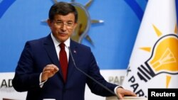 Turkish Prime Minister Ahmet Davutoglu speaks during a news conference at AKP headquarters in Ankara on May 5.