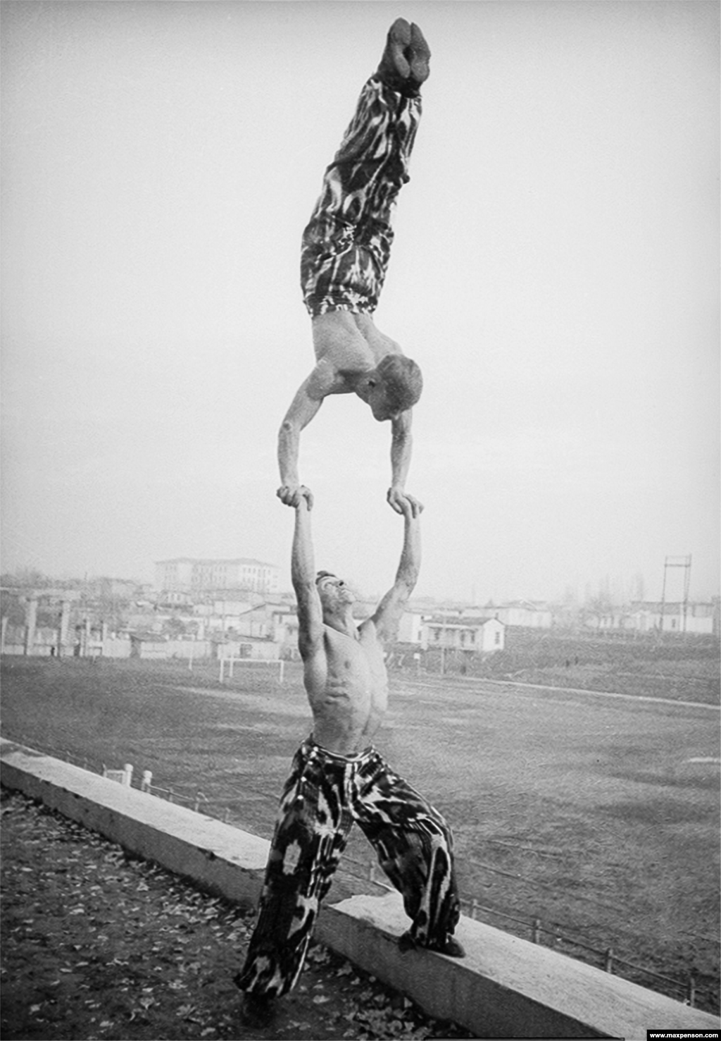 Two acrobats with an arm-quivering display of strength.