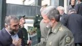 محسن فخریزاده (چپ) در کنار امیر حاتمی وزیر دفاع دولت دوم روحانی