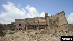 Damaged houses in a village in Pakistan's Kurram tribal district.