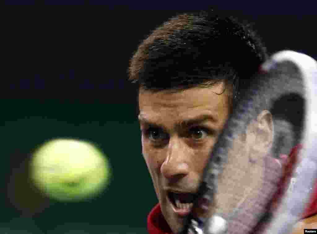 Novak Djokovic of Serbia returns a shot during his men's singles tennis match against Mikhail Kukushkin of Kazakhstan at the Shanghai Masters tennis tournament in Shanghai. Djokovic was victorious. (Reuters/Aly Song)