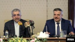 Syrian Electricity Minister Muhammad Zuhair Kharboutli (right) and Iranian counterpart Reza Ardakanian signed an agreement to rebuild Syria's electrical grid.