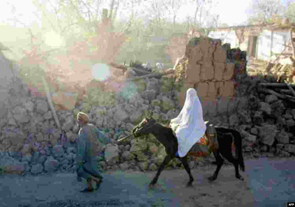 A man walks a horse carrying his wife through a street devastated by an earthquake in 2002 (AFP) - Under the constitution, women enjoy equal rights. In practice, the lives of women, particularly in the countryside, follow old patterns: no schooling, early arranged marriage, and – in a shocking number of cases – death during childbirth. Still, there have been improvements: girls can go to school, and women can work, appear on television, and sing in public.