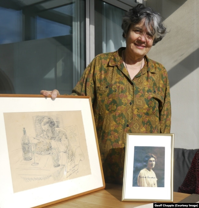 Miriam Kauders with a pencil sketch of her father, Cornelius, as drawn by Gertrud Kauders.