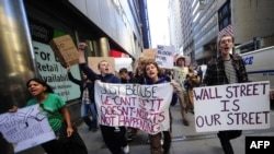 "U.S. -- Participants in the ""Occupy Wall Street"" demonstrate around Wall Street attempting to disrupt pedestrian flow for financial workers to get to work, in New York, 19Sep2011"