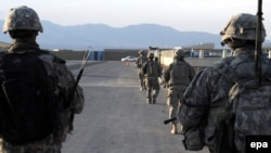 In this U.S. military handout photo, U.S. Army soldiers from Provincial Reconstruction Team-Paktika walk down a street in Sharana, in Afghanistan's Paktika Province, in 2009.