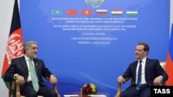 Russian Prime Minister Dmitry Medvedev and Afghan counterpart Abdullah Abdullah hold talks on the sidelines of a gathering of prime ministers of the Shanghai Cooperation Organization (SCO) in Astana on December 15.