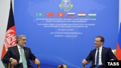 Russian former Prime Minister Dmitry Medvedev and Afghan counterpart Abdullah Abdullah hold talks on the sidelines of a gathering of prime ministers of the Shanghai Cooperation Organization (SCO) in Kazakhstan in 2014.