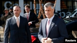 Kosovar Prime Minister Hashim Thaci (right) arrives for the talks in Brussels on April 2.