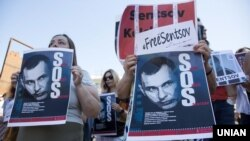 Posters of Oleh Sentsov during an action in support of Ukrainians illegally imprisoned in Russia held in Kyiv on June 2.