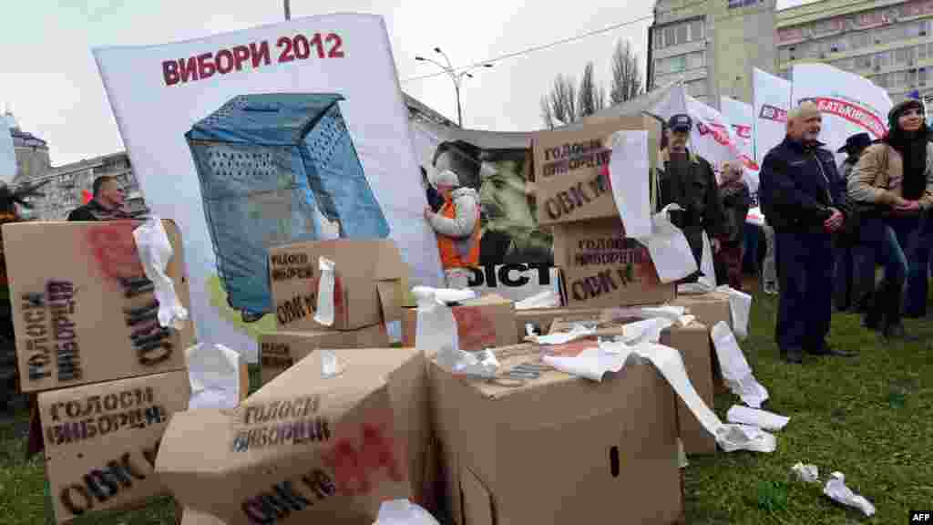 "Protesters set up mock ""ballot boxes."""