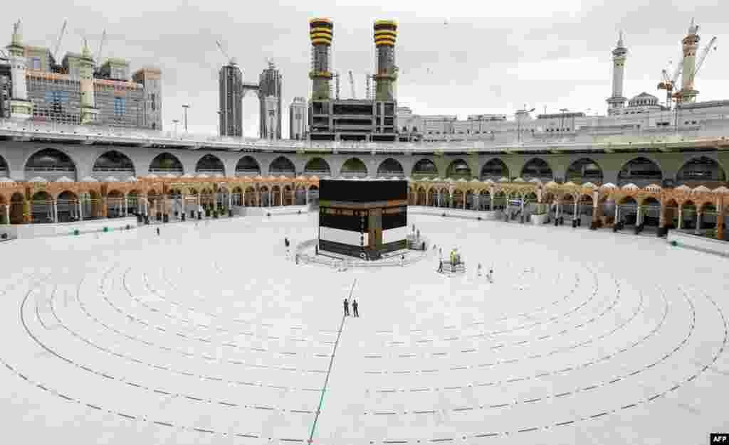 This picture shows a view of the Kaaba, Islam's holiest shrine, at the center of the Grand Mosque in the holy city of Mecca, ahead of the annual Muslim hajj pilgrimage, with rings laid in place around it to separate pilgrims as part of social-distancing measures.