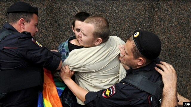 Russian riot policemen detain a gay rights activist during an unauthorized rally in central Moscow earlier this year.
