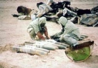 A screen capture from Iraqi television of UN personnel destroying mustard gas in the early 1990s (AFP)