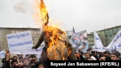 Afghan protesters burn an effigy of U.S. President Barack Obama. With just three years before the West hands off full control of the country's security, questions remain over Afghanistan's political maturity.