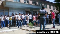 Uzbekistan - enrollees are in a queue for submitting documents near Samarkand State University