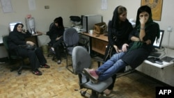 Journalists from Rouzegar, a reformist Tehran daily, sat in their editorial offices in September after receiving word of a two-month ban on their reporting.