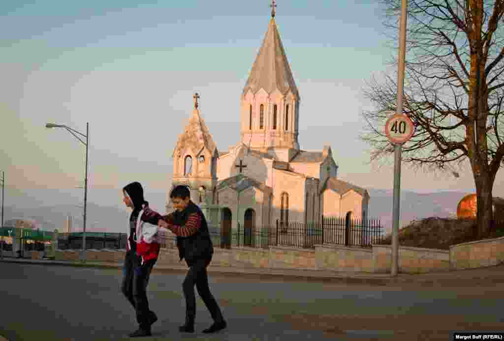 Children play in front of Ghazanchetsots Cathedral, completely reconstructed after the war, in the town of Shusha. Known as Shushi to its Armenian residents, the town was inhabited mainly by Azerbaijanis until the end of the war.