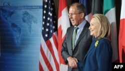 U.S. Secretary of State Hillary Clinton poses with Russian Foreign Minister Sergei Lavrov in Washington in April