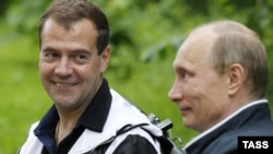 Russian President Dmitry Medvedev (left) and Prime Minister Vladimir Putin